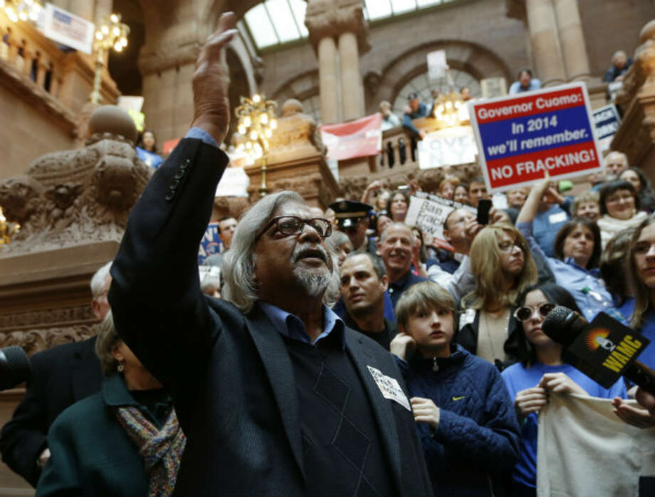 Arun Gandhi, grandson of nonviolent protest leader Mahatma Gandhi, speaks during an anti-hydraulic fracturing rally on the Million Dollar Staircase at the Capitol in Albany, N.Y. Photo: AP Photo/Mike Groll