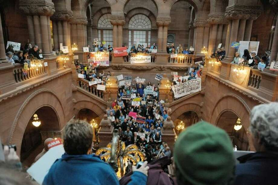 Protestors who are against the State allowing hydraulic fracturing, hold a rally on the Million Dollar Staircase inside the Capitol. Photo: Paul Buckowski / Times Union