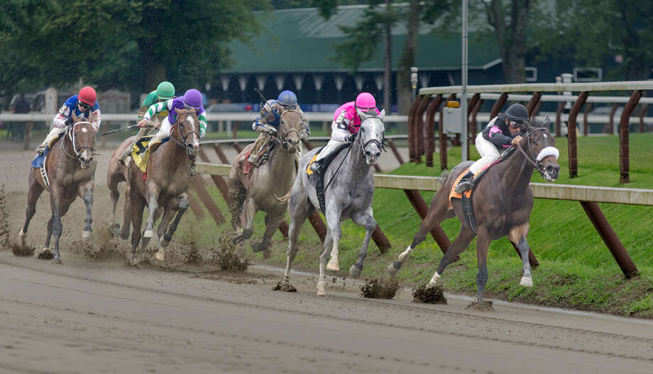 Prize winner #3. Taken on July 29, 2013, this was a tight group on a sloppy track.  I have no idea who won since I was more interested in taking the shot. (Mike Mosher)