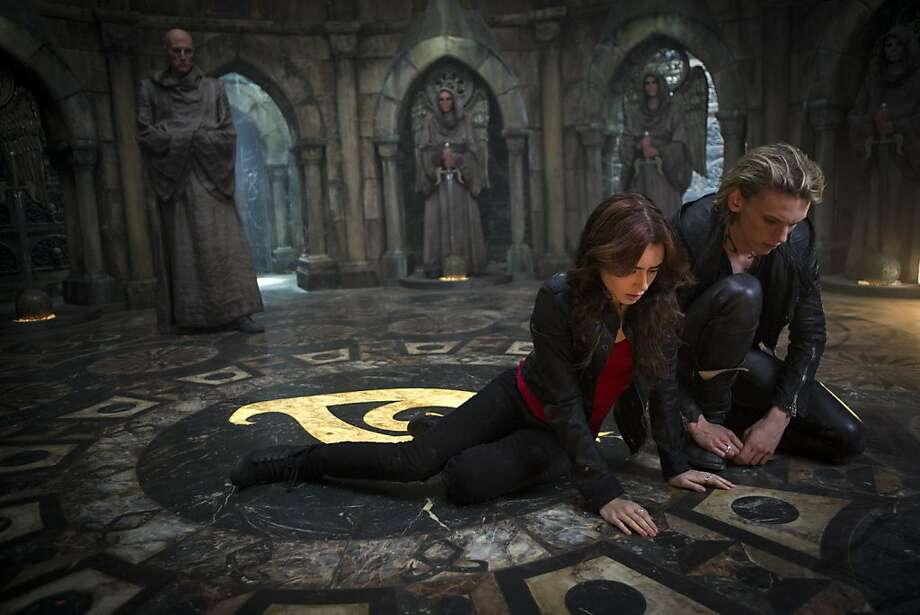 "Clary (Lily Collins) joins forces with Jace (Jamie Campbell Bower) as he leads a battle against Valentine (Jonathan Rhys Meyers) in ""The Mortal Instruments: City of Bones."" Photo: Rafy, Sony Pictures"