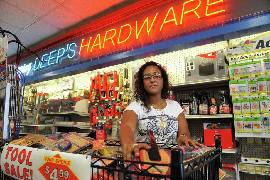 Leslie Marine, 18, who is going into her senior year at Danburyl High School, works at Deep's Hardware store on Monday, Aug. 19, 2013, in Danbury, Conn. Photo: Michael Duffy / The News-Times