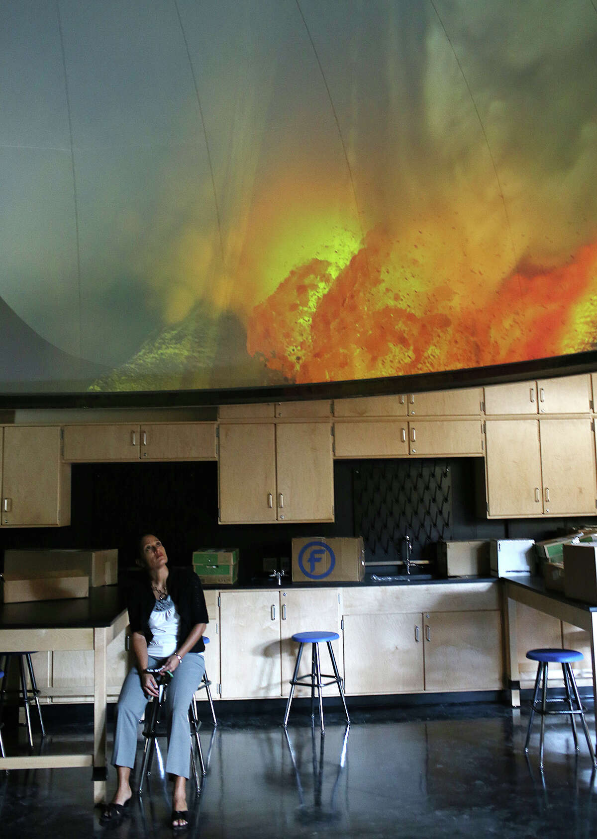 South San Antonio Independent School District director of child nutrition Jenny Arredondo checks out a volcanism video on a planetarium at the new South San High School, Monday, Aug. 19, 2013. The school is part of a $58 million bond and will open with the coming school year.