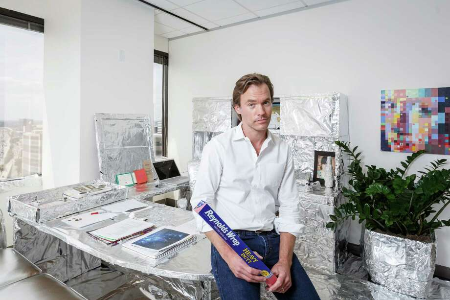 Co-workers of Scott Brown, president and chief creative officer of FKM advertising agency, wrapped his office in aluminum foil as an elaborate office prank. (Michael Paulsen / Houston Chronicle) Photo: Michael Paulsen, Staff / © 2013 Houston Chronicle
