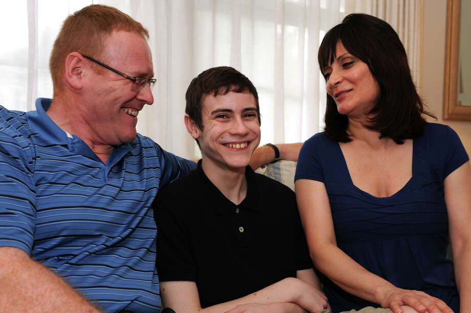 Max Wheeler, 13, sits with his parents Doug and Maria in their Trumbull, Conn. home, Aug. 19, 2013. Max has been fighting a debilitating case of Lyme disease, and his parents have sought Sen. Richard BlumenthalâÄôs help in dealing with their health insurance company. Photo: Ned Gerard / Connecticut Post