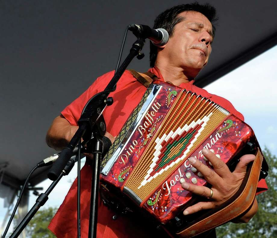 "A photograph of Joel Guzman performing at the International Accordion Festival is included in the exhibit ""Cinco Anos."" Photo: Courtesy Photo"