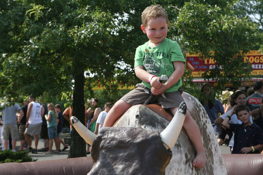 Ride a mechanical bull at The Blues, Views and BBQ Festival at Jesup Green in Westport on Saturday, Aug. 31 and Sunday, Sept. 1. Photo: Unknown, B.K. Angeletti / Connecticut Post freelance B.K. Angeletti