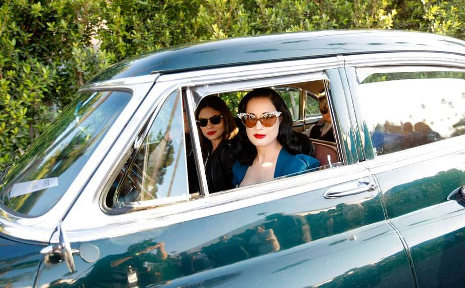 Actress Dita Von Teese arrives in her classic Cadillac at the 9th Annual Johnny Ramone Tribute at Hollywood Forever on August 18, 2013 in Hollywood, California.  (Photo by Sean tSabhasaigh/Getty Images) Photo: Sean TSabhasaigh, Getty Images