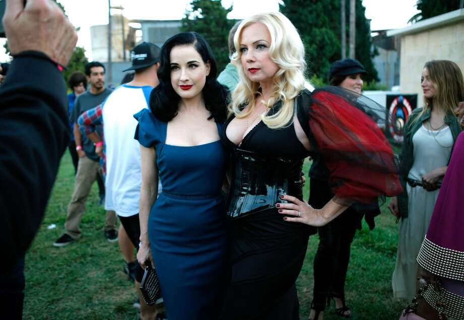 Actresses Dita Von Teese (L) and Traci Lords arrive at the 9th Annual Johnny Ramone Tribute at Hollywood Forever on August 18, 2013 in Hollywood, California.  (Photo by Sean tSabhasaigh/Getty Images) Photo: Sean TSabhasaigh, Getty Images