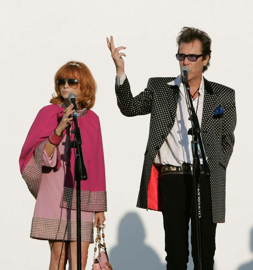 Linda Ramone (L) and musician Slim Jim Phantom (R) talk to the Ramones fans and guests at the 9th Annual Johnny Ramone Tribute at Hollywood Forever on August 18, 2013 in Hollywood, California.  (Photo by Sean tSabhasaigh/Getty Images) Photo: Sean TSabhasaigh, Getty Images