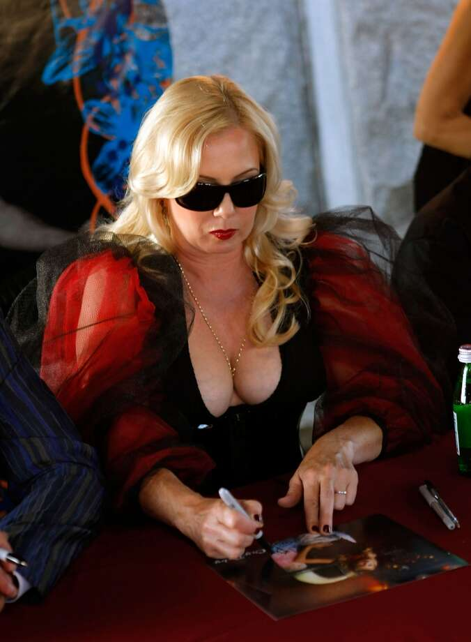 Actress Traci Lords signs autographs at the 9th Annual Johnny Ramone Tribute at Hollywood Forever on August 18, 2013 in Hollywood, California.  (Photo by Sean tSabhasaigh/Getty Images) Photo: Sean TSabhasaigh, Getty Images