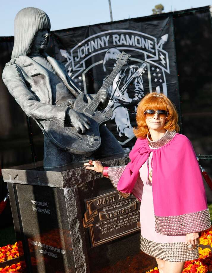 Linda Ramone poses in front of Johnny Ramone bronze statue at the 9th Annual Johnny Ramone Tribute at Hollywood Forever on August 18, 2013 in Hollywood, California.  (Photo by Sean tSabhasaigh/Getty Images) Photo: Sean TSabhasaigh, Getty Images