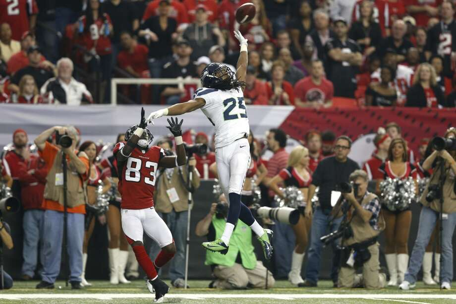 Richard Sherman defends a pass intended for Harry Douglas of the Atlanta Falcons during the NFC Divisional Playoff Game. Photo: Joe Robbins, Getty Images