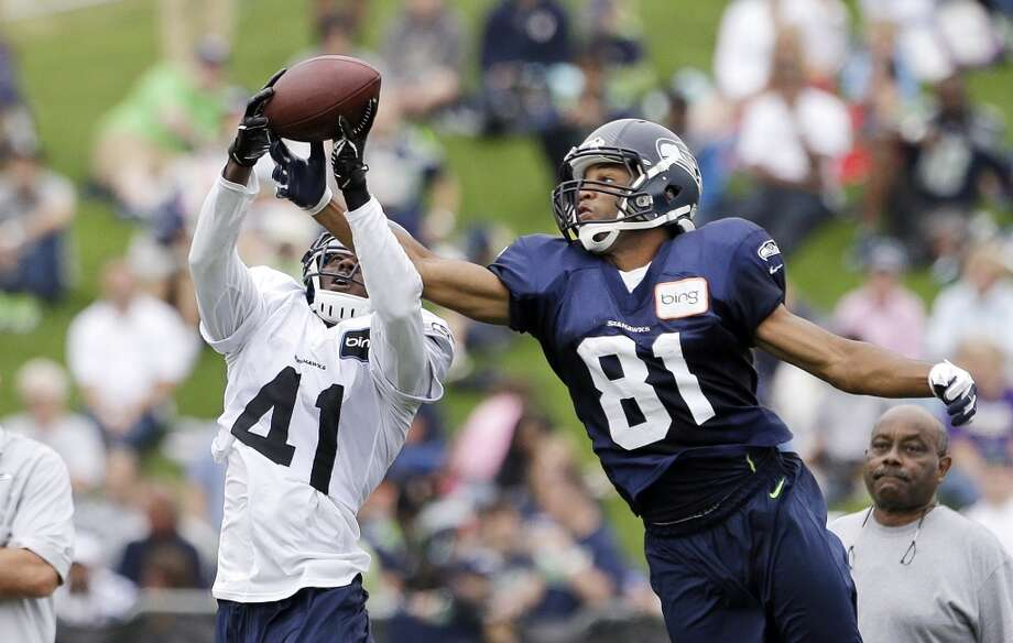 Byron Maxwell intercepts a pass intended for Golden Tate at Seahawks training camp. Photo: Elaine Thompson, AP