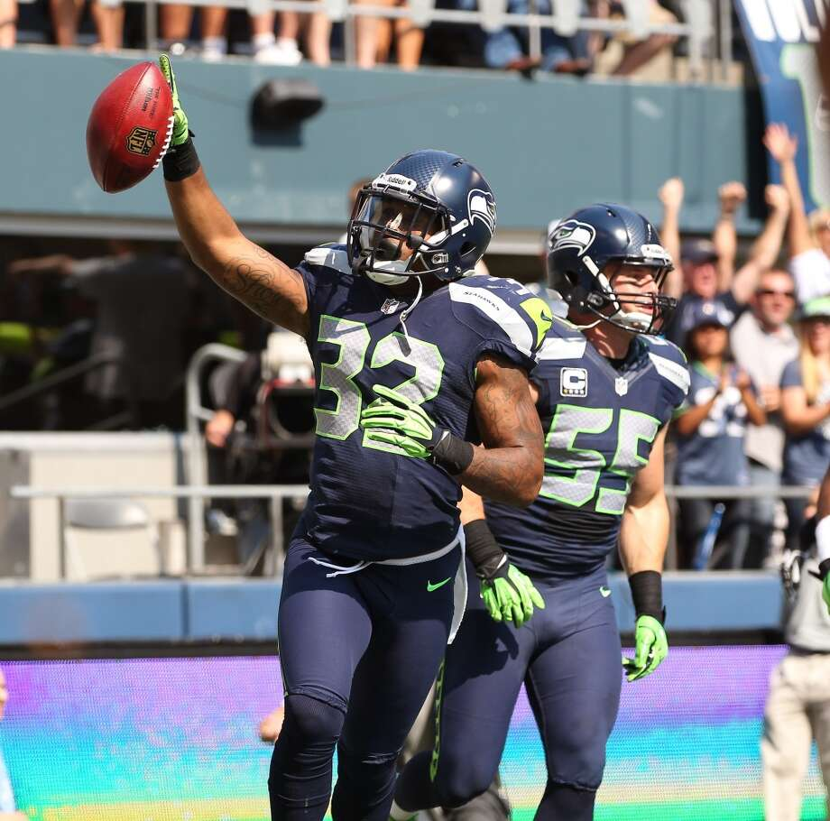 Jeron Johnson celebrates after recovering a blocked punt and returning it for a touchdown against the Dallas Cowboys at CenturyLink Field on September 16, 2012. Photo: Otto Greule Jr, Getty Images
