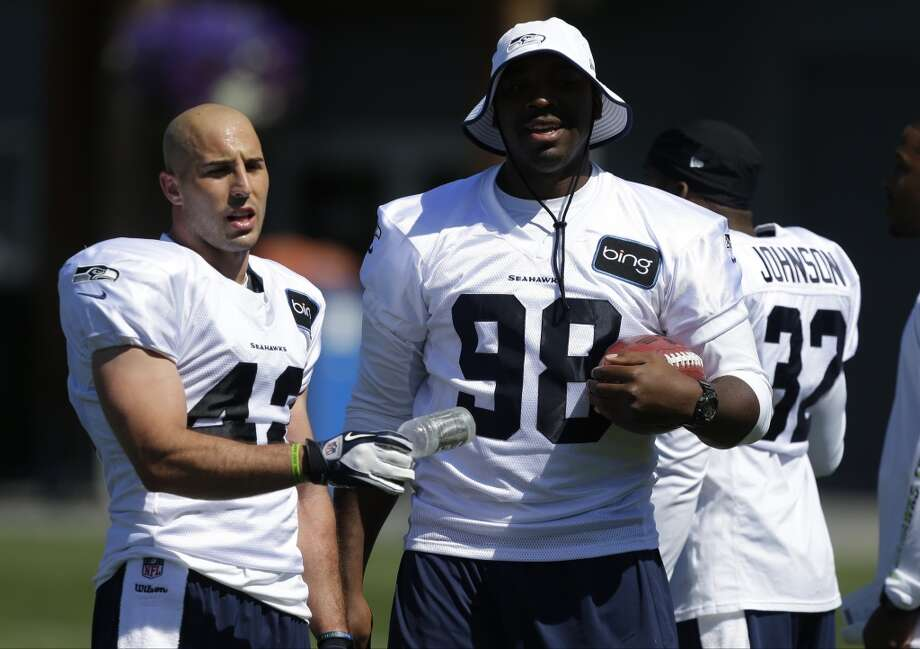 Chris Maragos and Greg Scruggs during Seahawks training camp. Photo: Ted S. Warren, AP