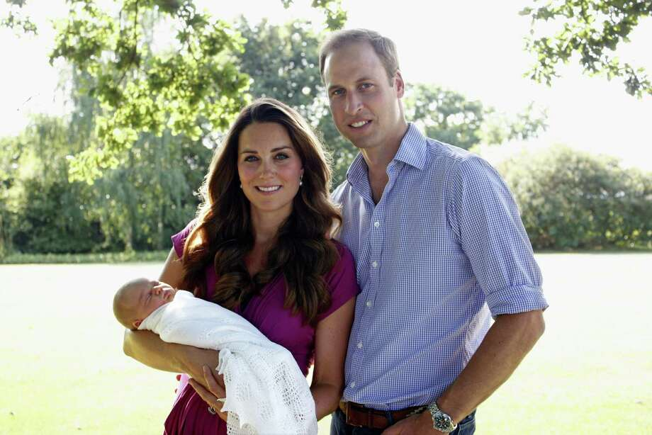 In this handout image provided by Kensington Palace, Catherine, Duchess of Cambridge and Prince William, Duke of Cambridge pose for a photograph with their son, Prince George Alexander Louis of Cambridge in the garden of the Middleton family home in August 2013 in Bucklebury, Berkshire. Photo: Handout, Getty Images / 2013 Getty Images