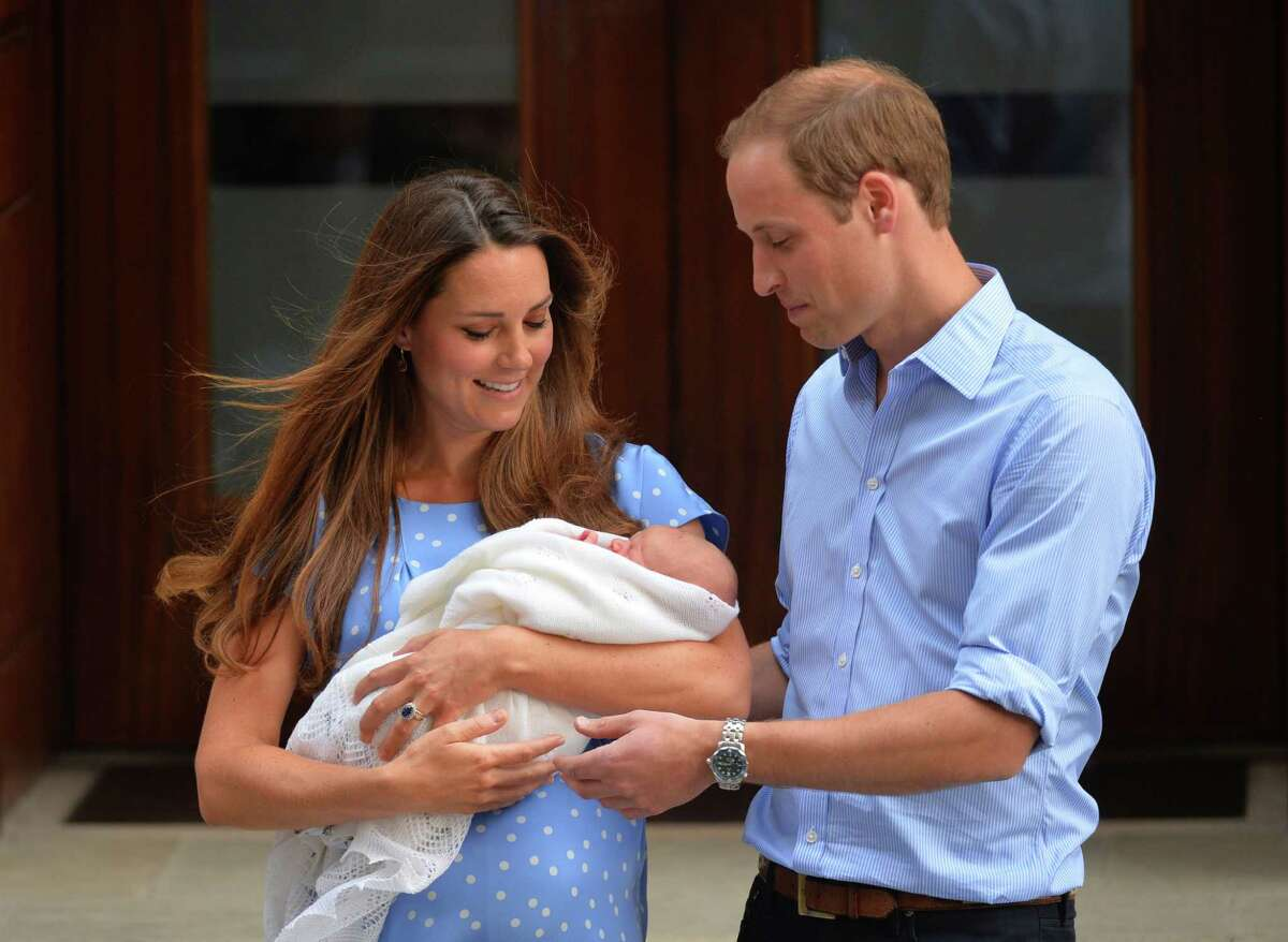 In a file picture taken on July 23, 2013, Prince William, Duke of Cambridge, and Catherine, Duchess of Cambridge show their new-born baby boy, Prince George of Cambridge, to the world's media outside the Lindo Wing of St Mary's Hospital in London.