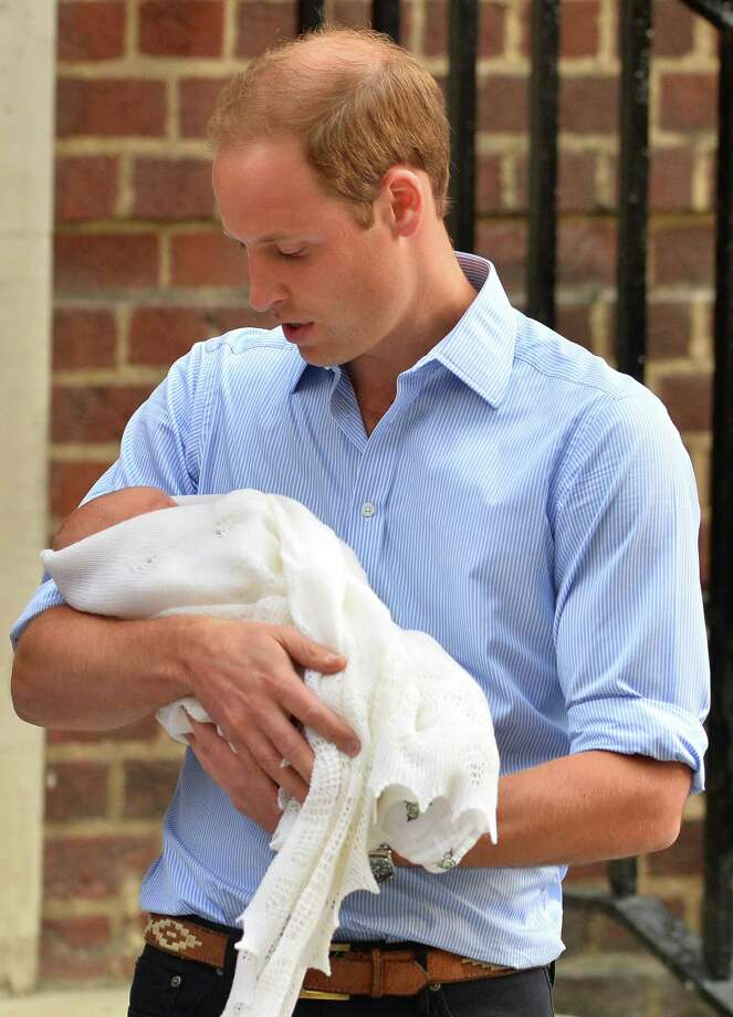 "Prince William, Duke of Cambridge, holds his new-born son, Prince George of Cambridge, as he and his wife present him to the world's media outside the Lindo Wing of St Mary's Hospital in London. Speaking to CNN in an interview on August 19, Prince William has described his newborn son George as a ""bit of a rascal"" and admitted that fatherhood has changed him already.  Photo: BEN STANSALL, AFP/Getty Images / AFP ImageForum"