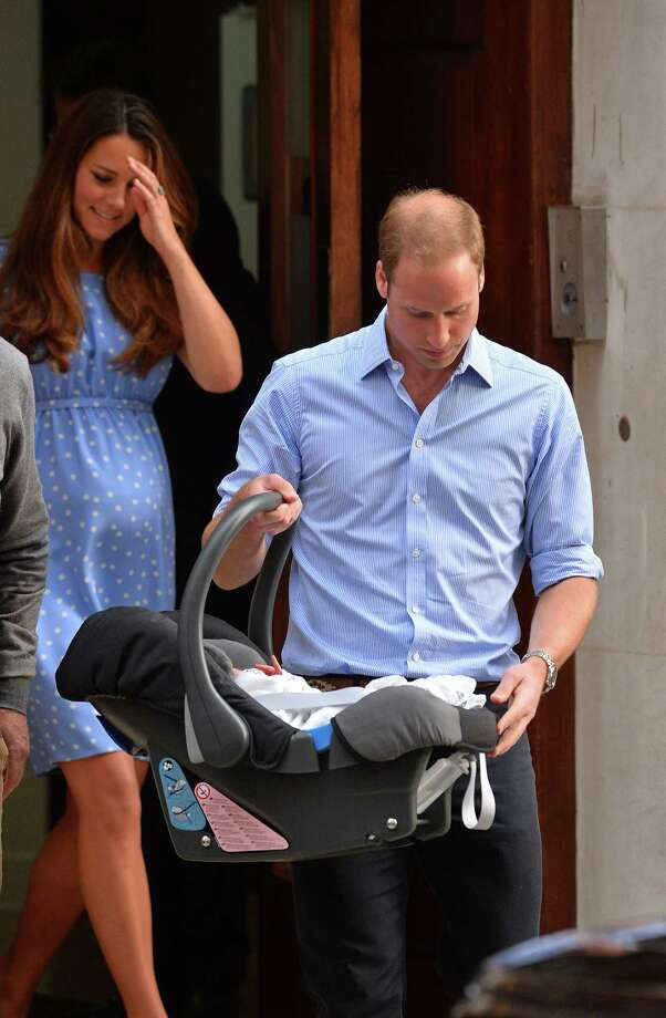 Prince William, Duke of Cambridge, carries his new-born son, Prince George of Cambridge, to the car after he and Catherine, Duchess of Cambridge, presented th new-born to the world's media in July outside the Lindo Wing of St Mary's Hospital in London.  Photo: BEN STANSALL, AFP/Getty Images / AFP ImageForum
