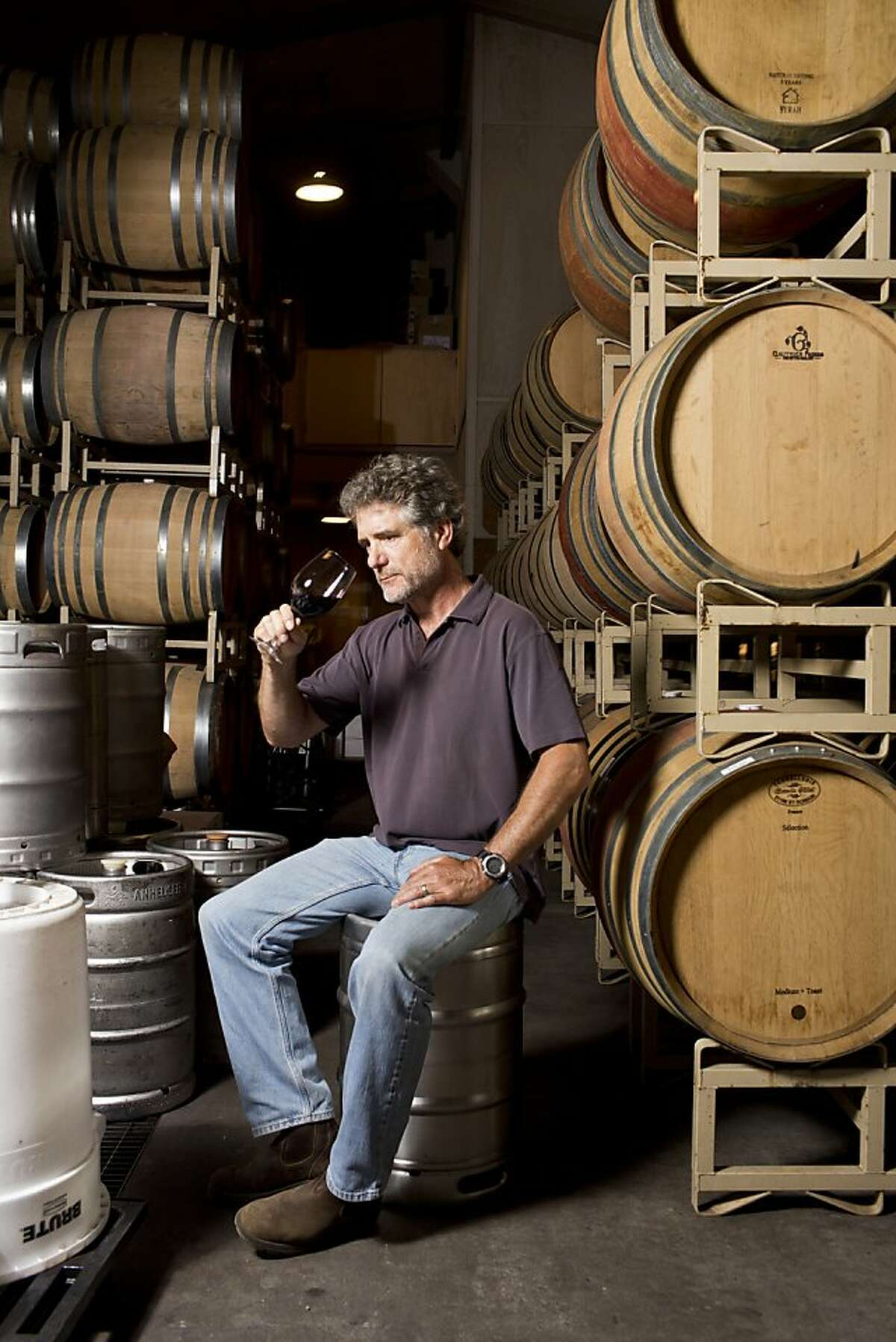 Tom Farella, of Farella Vineyard, on a ladder in his winemaking cellar in Coombsville, Calif., Thursday, August 15, 2013.