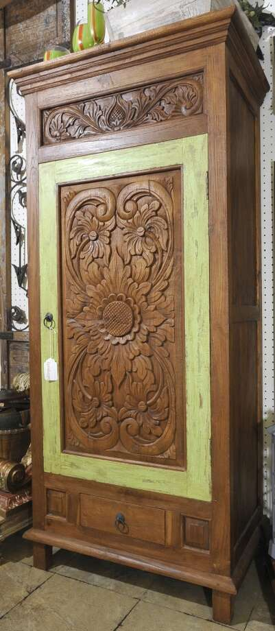 For the next cat5 Fresh Biz, Christina checks out Balimports, a new Calder Avenue store specializing in handcrafted and artisan housewares.  This is a teak hand carved cabinet. Dave Ryan/The Enterprise Photo: Dave Ryan/The Enterprise