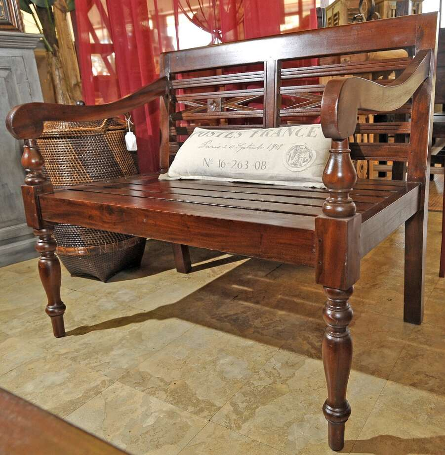 For the next cat5 Fresh Biz, Christina checks out Balimports, a new Calder Avenue store specializing in handcrafted and artisan housewares.  This is a mahogany garden bench.  Dave Ryan/The Enterprise Photo: Dave Ryan/The Enterprise