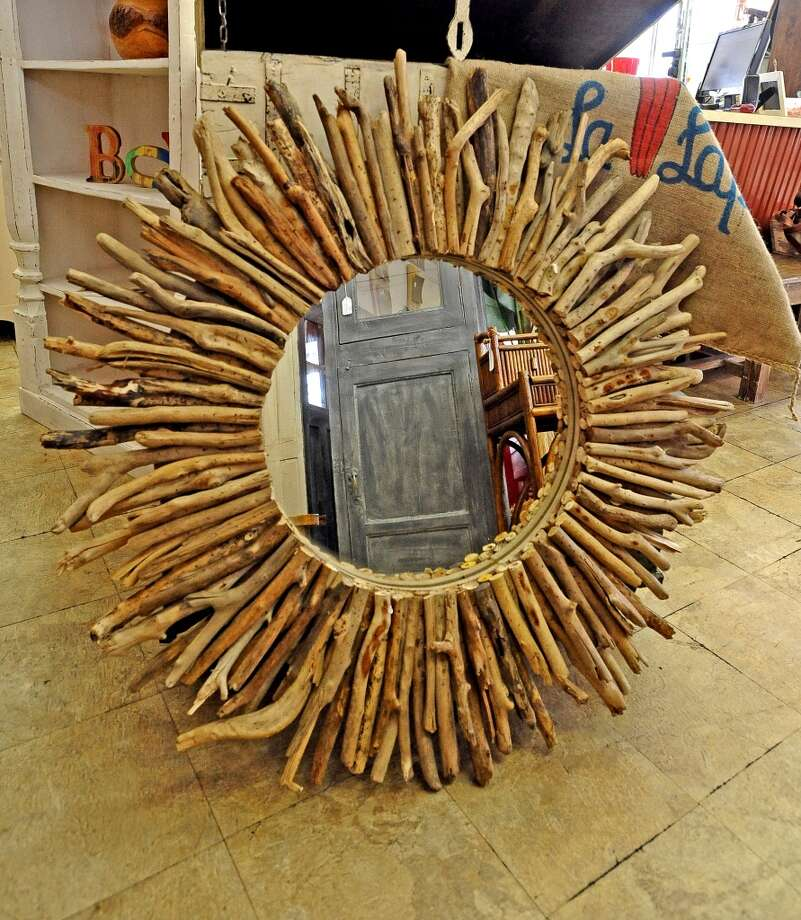 Balimports in Beaumont offers a repurposed mirror decorated with drift wood.  Photo taken Friday, July 12, 2013. Photo taken: Randy Edwards/The Enterprise