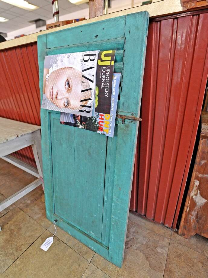 Balimports in Beaumont offers a repurposed shutter used as a magazine rack.  Photo taken Friday, July 12, 2013. Photo taken: Randy Edwards/The Enterprise