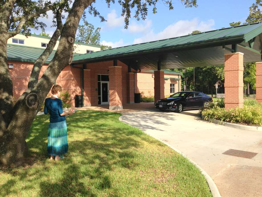 Page Turners book club member Rita Fishback enters the Kingwood Community Center. Photo: Contributed