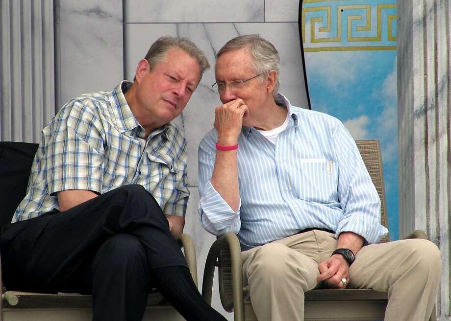 Al Gore (left) talks to Senate Majority Leader Harry Reid at the 17th annual Tahoe Summit. Photo: Sandra Chereb, Associated Press