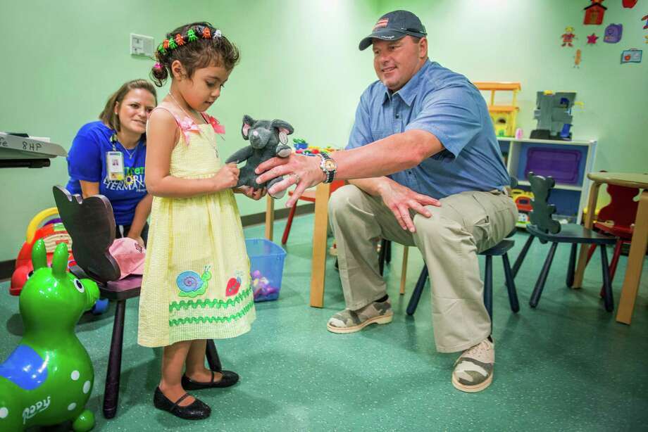 Roger Clemens greets four-year-old HeartGift patient Mariangel with a signed pink Houston Astros baseball cap, a stuffed animal, heart lollipops and more. Mariangel traveled from her home in Nicaragua this week and is scheduled to receive heart surgery from leading pediatric cardiothoracic surgeon William I. Douglas, M.D. on Thursday. She is HeartGift's 11th patient to receive a life-saving heart surgery at Children's Memorial Hermann Hospital. Photo: Smiley N. Pool, Houston Chronicle / © 2013  Houston Chronicle