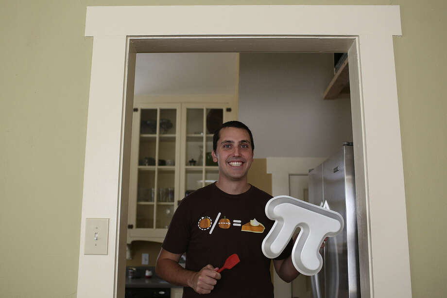 "At his San Antonio home, Garrett Heath holds a pi pan he created for making pi-shaped pies. He was helped by Kickstarter, a ""crowd-funding"" website whose users gave him $7,848, allowing him to place an order for hundreds of the pans. Photo: Lisa Krantz / San Antonio Express-News"