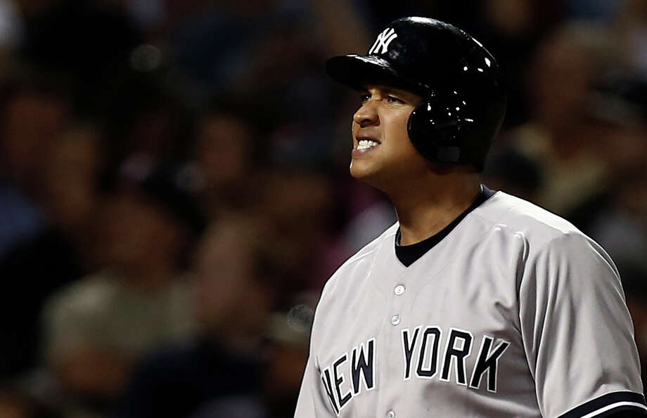 New York Yankees' Alex Rodriguez grimaces after fouling off a pitch during the fifth inning of a baseball game against the Boston Red Sox at Fenway Park in Boston on Friday, Aug. 16, 2013. (AP Photo/Winslow Townson) ORG XMIT: BXF120 Photo: Winslow Townson / FR170221 AP