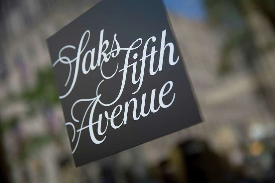 The Saks Fifth Avenue logo is displayed at the company's store in New York, U.S., on Monday, July 29, 2013. Hudson's Bay Co. agreed to buy Saks Inc. for $2.4 billion, combining Canada's largest-department store chain with one of the most prestigious U.S. luxury retailers in a deal that may spur the creation of a real estate investment trust. Photographer: Scott Eells/Bloomberg Photo: Scott Eells / © 2013 Bloomberg Finance LP