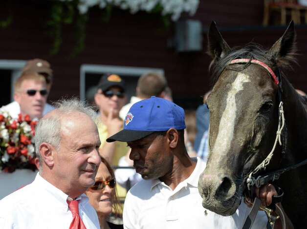 Trainer/owner Jimmy Iselin, left, in the winner's circel with his charge Willet after winning the 10th running of The Union Avenue Monday afternoon, Aug 19, 2013, at Saratoga Race course in Saratoga Springs, N.Y. (Skip Dickstein/Times Union) Photo: SKIP DICKSTEIN