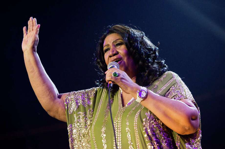 """FILE - In this May 11, 2013 file photo, Aretha Franklin performs during McDonald's Gospelfest 2013 at the Prudential Center in Newark, N.J. Franklin will not be attending a baseball luncheon during which she was to receive an honor for contributions to civil rights. Franklin, 71, has already canceled several concerts recently because of undisclosed health reasons. In a statement issued Monday, Aug. 19, by Major League Baseball, the Grammy-winning singer referred to ongoing """"treatment"""" that prevented her from traveling.  (Photo by Charles Sykes/Invision/AP, File) Photo: Charles Sykes, INVL / Invision"""