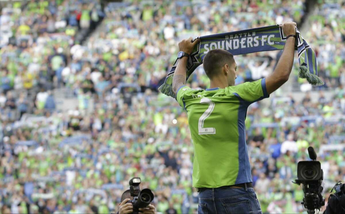 Fans look on as Clint Dempsey, the U.S. men's team captain and native of Nacogdoches, is introduced by the Seattle Sounders.