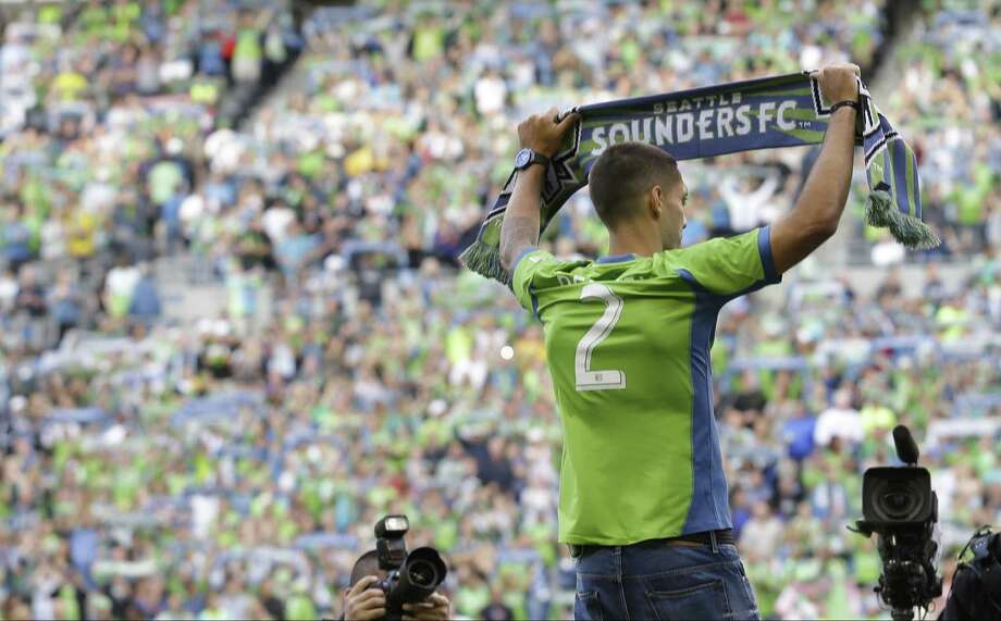 Fans look on as Clint Dempsey, the U.S. men's team captain and native of Nacogdoches, is introduced by the Seattle Sounders. Photo: Ted S. Warren / Associated Press