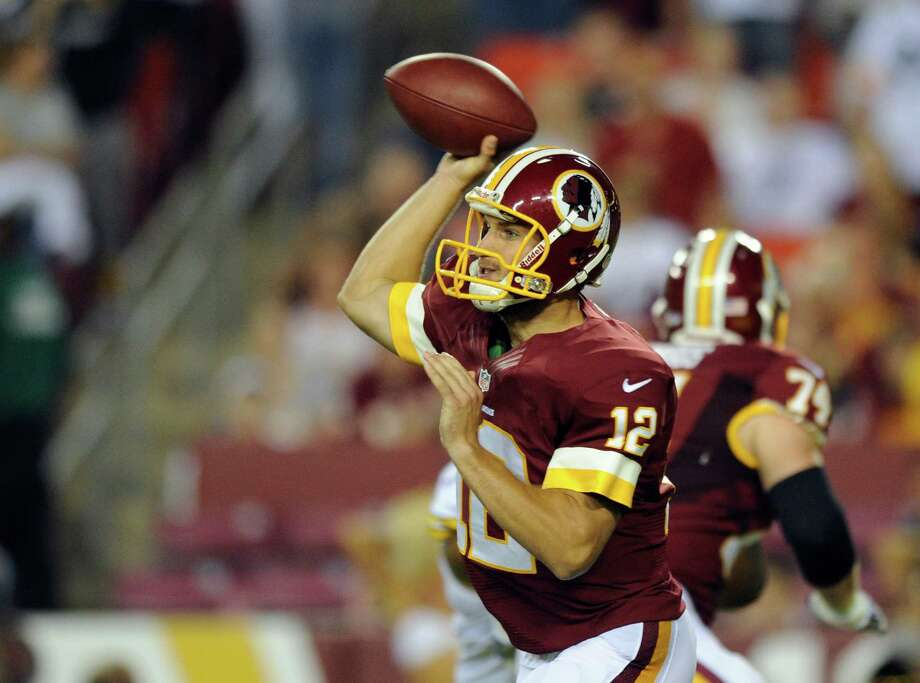 Washington Redskins quarterback Kirk Cousins (12) throws during the first half of an NFL preseason football game against the Pittsburgh Steelers Monday, Aug. 19, 2013, in Landover, Md. (AP Photo/Nick Wass) ORG XMIT: FDX111 Photo: Nick Wass / FR67404 AP