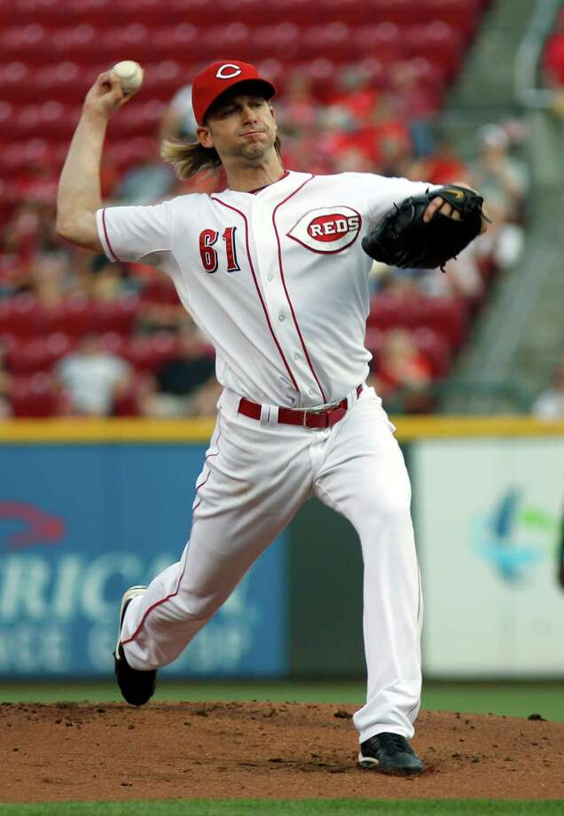 Cincinnati Reds starting pitcher Bronson Arroyo throws against the Arizona Diamondbacks in the first inning of a baseball game, Monday, Aug. 19, 2013, in Cincinnati. (AP Photo/David Kohl) ORG XMIT: OHDK101 Photo: David Kohl / FR51830 AP