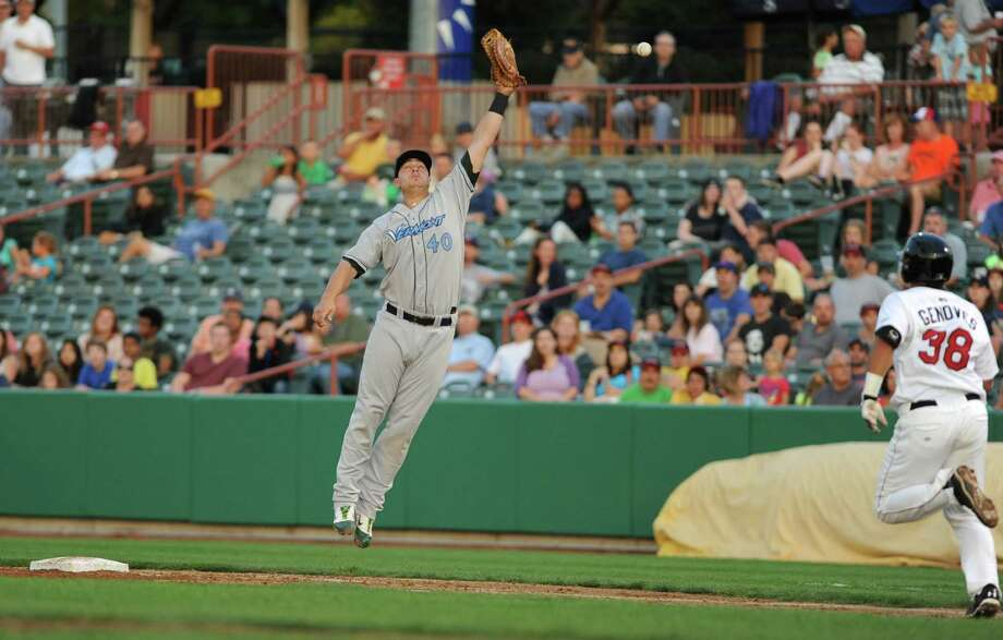 Tri-City ValleyCats Ernesto Genoves is safe at first because of an overthrown ball to Ryan Huck of the Vermont Lake Monsters during a baseball game at Joe Bruno Stadium on Monday, Aug. 19, 2013 in Troy, N.Y. (Lori Van Buren / Times Union) Photo: Lori Van Buren / 00023557A