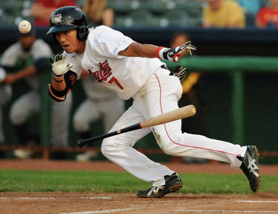 Tri-City ValleyCats Chan Moon lays down a perfect bunt to advance a runner to second and to get him to first base safely during a baseball game against Vermont at Joe Bruno Stadium on Monday, Aug. 19, 2013 in Troy, N.Y. (Lori Van Buren / Times Union) Photo: Lori Van Buren / 00023557A