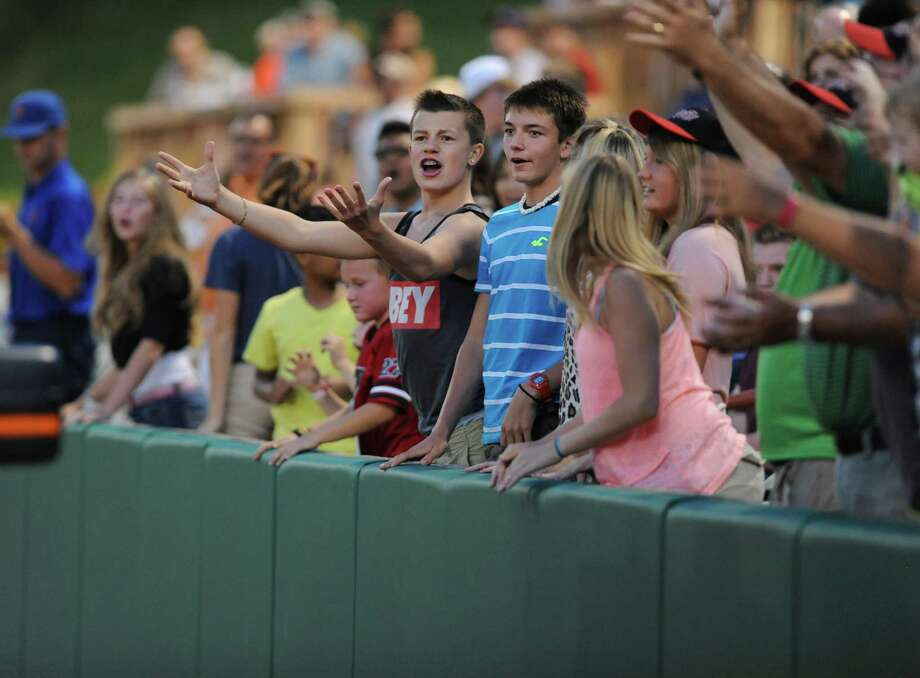 Tri-City ValleyCats fans look for free t-shirts to be thrown to them during a baseball game against Vermont at Joe Bruno Stadium on Monday, Aug. 19, 2013 in Troy, N.Y. (Lori Van Buren / Times Union) Photo: Lori Van Buren / 00023557A