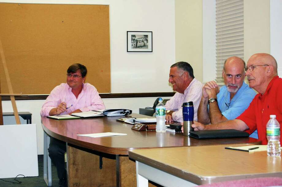 Parks and Recreation Director Stuart McCarthy, far left, with members of the Parks and Recreation Commission and the Golf Advisory Committee, discuss the proposal to hire an outside vendor to manage Longshore Golf Course. Photo: Cameron Martin / Westport News