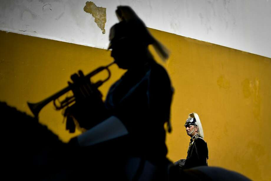 Members of the mounted brass band of Portugal's National Guard gather to take part in the ceremony of Changing the Guard, at the National Guard Cavalry Regiment headquarters in Lisbon, on August 18, 2013. The cavalry of Portugal's National Guard has a unique mounted brass band which was created in 1942. It features various instruments including cavalry trumpets, flugelhorn and kettledrum. The cavalry, which consists of 130 white or piebald horses and 27 riders, take part in various official ceremonies and touristic events, including the Change of Guards at Belem's National Palace.  TOPSHOTS/AFP PHOTO / PATRICIA DE MELO MOREIRAPATRICIA DE MELO MOREIRA/AFP/Getty Images Photo: Patricia De Melo Moreira, AFP/Getty Images