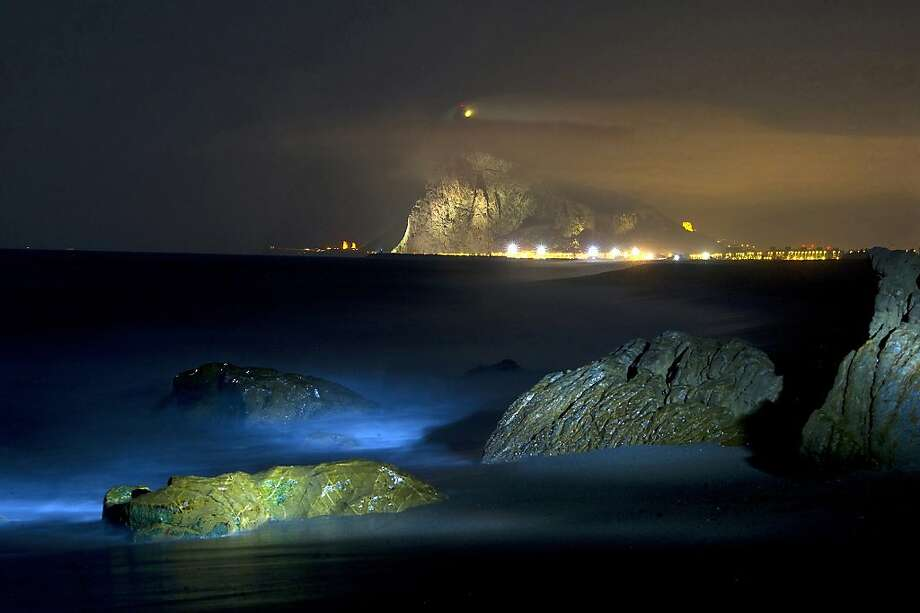 Gateway to the Mediterranean:A long-exposure photograph taken on Levante beach in La Linea de la Concepcion shows the Rock of Gibraltar. Photo: Marcos Moreno, AFP/Getty Images