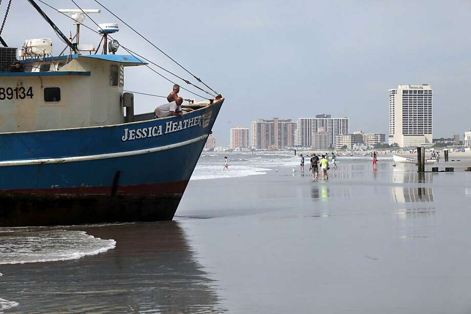 Crew members remain aboard the fishing vessel that ran aground in Atlantic City, N.J., Monday, Aug. 19, 2013. The Jessica Heather, a 56-foot fishing boat, has run aground near Caesar's Pier in Atlantic City. (AP Photo/The Press of Atlantic City, Michael Ein) Photo: Vernon Ogrodnek, Associated Press