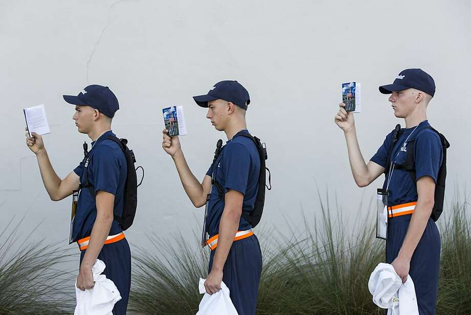 CHARLESTON, SC - AUGUST 19:  Incoming Citadel freshman known as knobs stand in formation as they read from the Guidon while waiting to be issued a uniform at The Citadel, The Military College of South Carolina on August 19, 2013 in Charleston, South Carolina. The Citadel which began in 1842, has more than 700 incoming freshmen this year selected from a pool of 2,958 applicants, the largest in the history of the South Carolina military college. The name knob comes from the shaved heads of the freshman which resemble a door knob.  (Photo by Richard Ellis/Getty Images) Photo: Richard Ellis, Getty Images