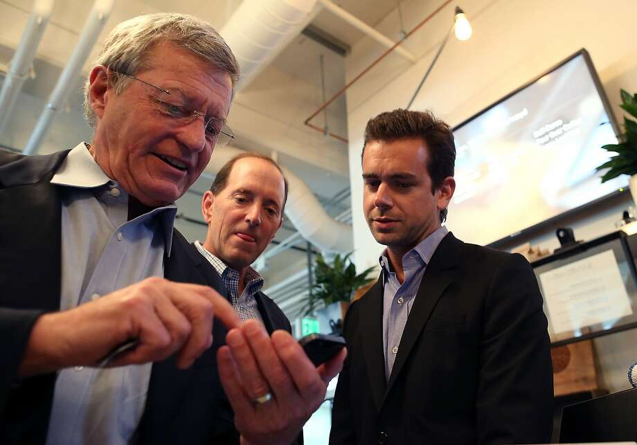 Square CEO Jack Dorsey (right) and Rep. Dave Camp, R-Mich., look on as Sen. Max Baucus attempts to download the now-defunct Square Wallet app in S.F. Photo: Justin Sullivan, Getty Images