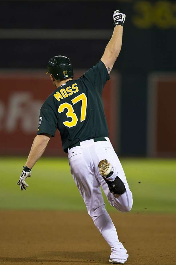 The A's Brandon Moss enjoys his game-ending tour of the bases. Photo: Jason O. Watson, Getty Images